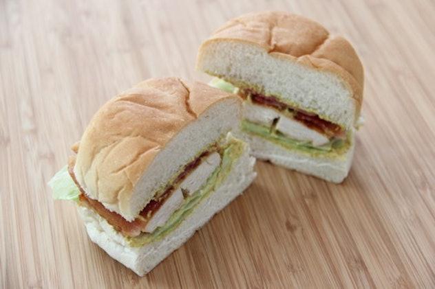 Chicken sandwich on a roll cut in half