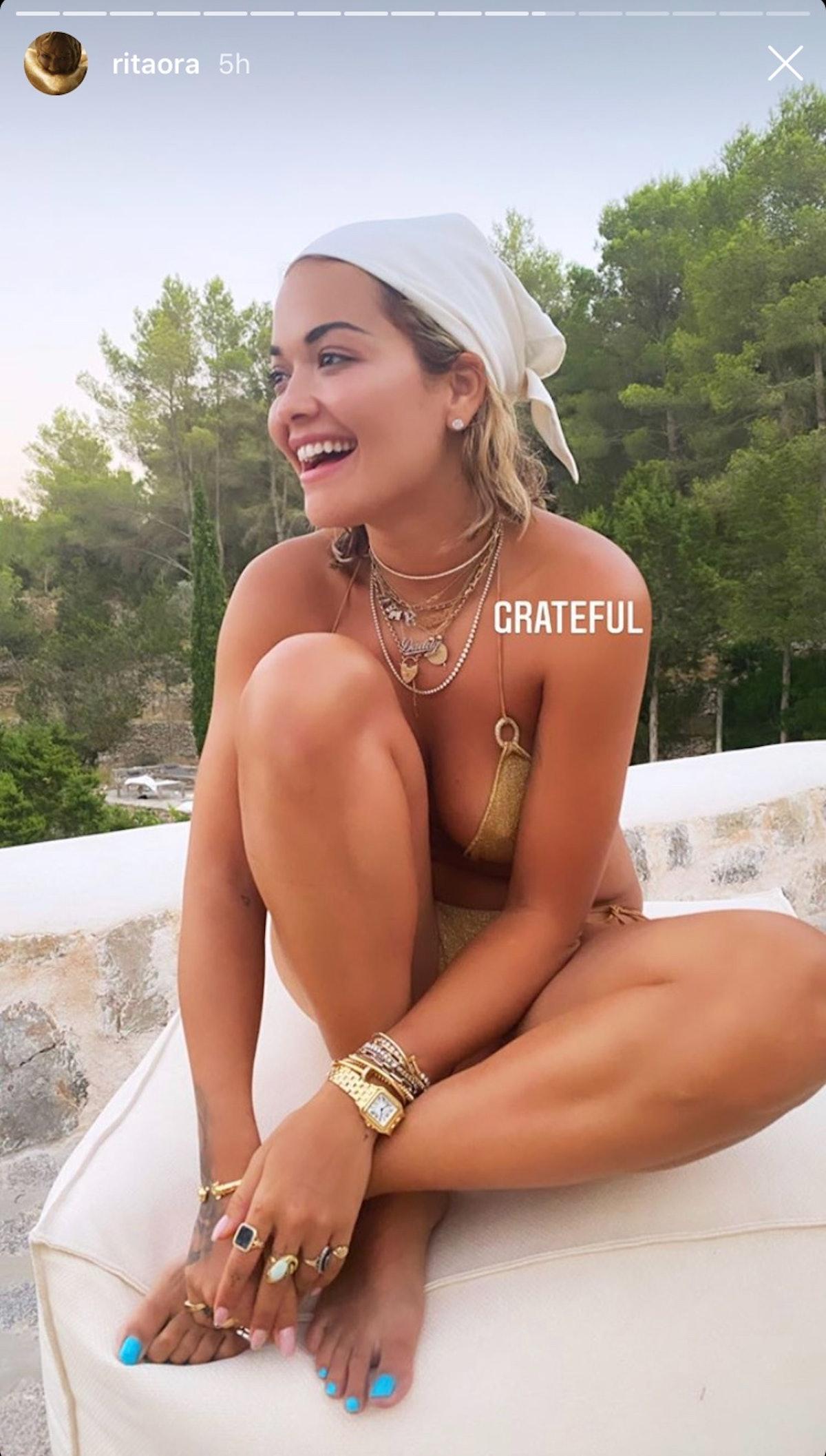 Rita Ora's aqua toenail polish popped perfect against her gold bikini