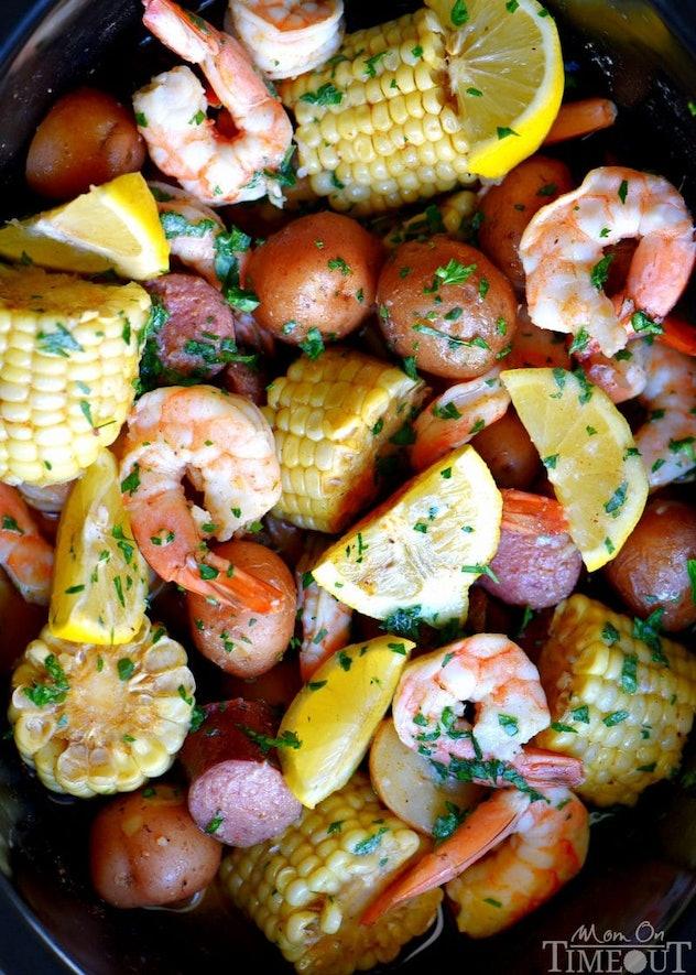 Shrimp boil (shrimp, corn, potatoes, lemons) on a plate