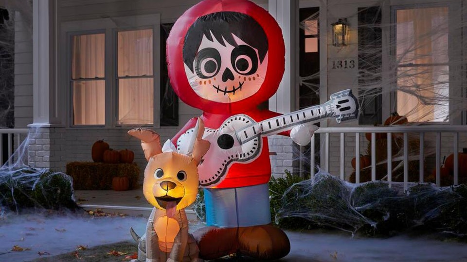 This Coco Halloween inflatable yard decoration features characters Miguel and Dante.