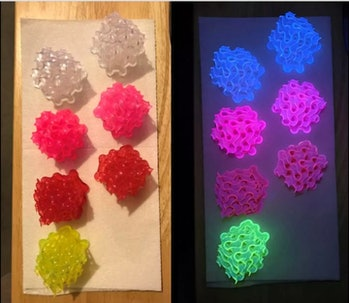 Seven fluorescent lights are first seen on a counter with the lights on. In the second image, the same lights are in the dark but this time, they are glowing brightly.