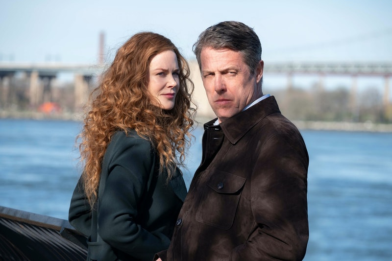Nicole Kidman and Hugh Grant stand by the banks of a river in a still from The Undoing