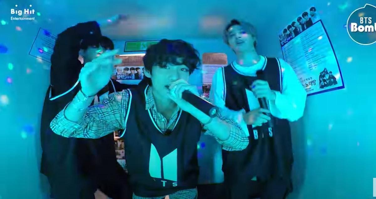 """A Screenshot From The Video Of BTS' Jimin, Jungkook, and V Singing """"Zero O'Clock"""" At Karaoke."""
