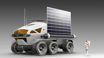A render of the Lunar Cruiser with a large solar panel on its side.