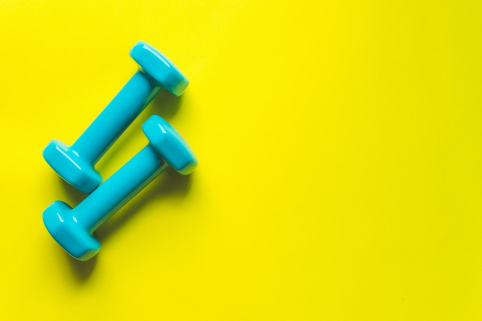 Dumbbells on a yellow background.