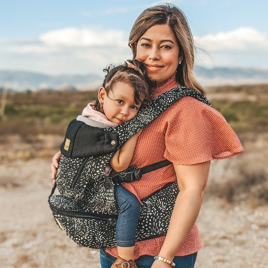 Promotional picture of woman wearing her toddler using the SeatMe