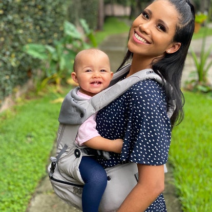 LÍLLÉbaby SeatMe promotional shot, woman carrying toddler on her front using the SeatMe carrier