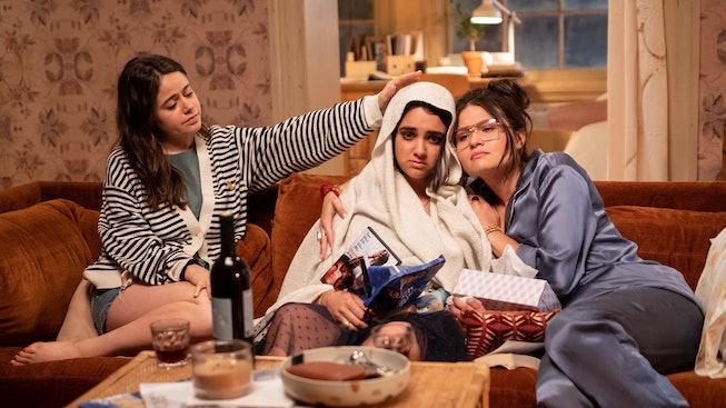 Amanda (Molly Gordon) and Nadine (Phillipa Soo) try to help Lucy (Geraldine Viswanathan, center) fee...