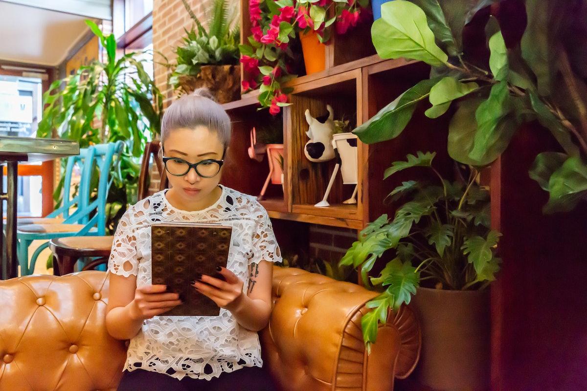 A lady reading a menu