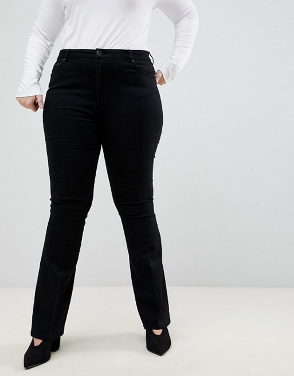 Curve bell flare jeans in clean black with pressed crease