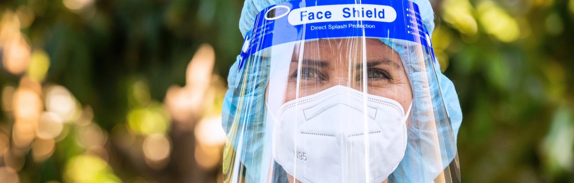 Hospital worker wearing a face shield.