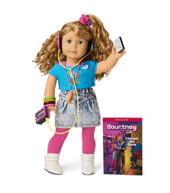 An American Girl doll named Courtney Moore can be seen in 1980s garb, faded shorts, blue shirt, and she's holding a walkman.