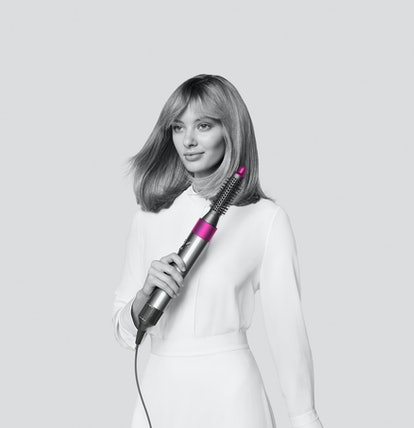 Dyson's new Airwrap attachments used on model.
