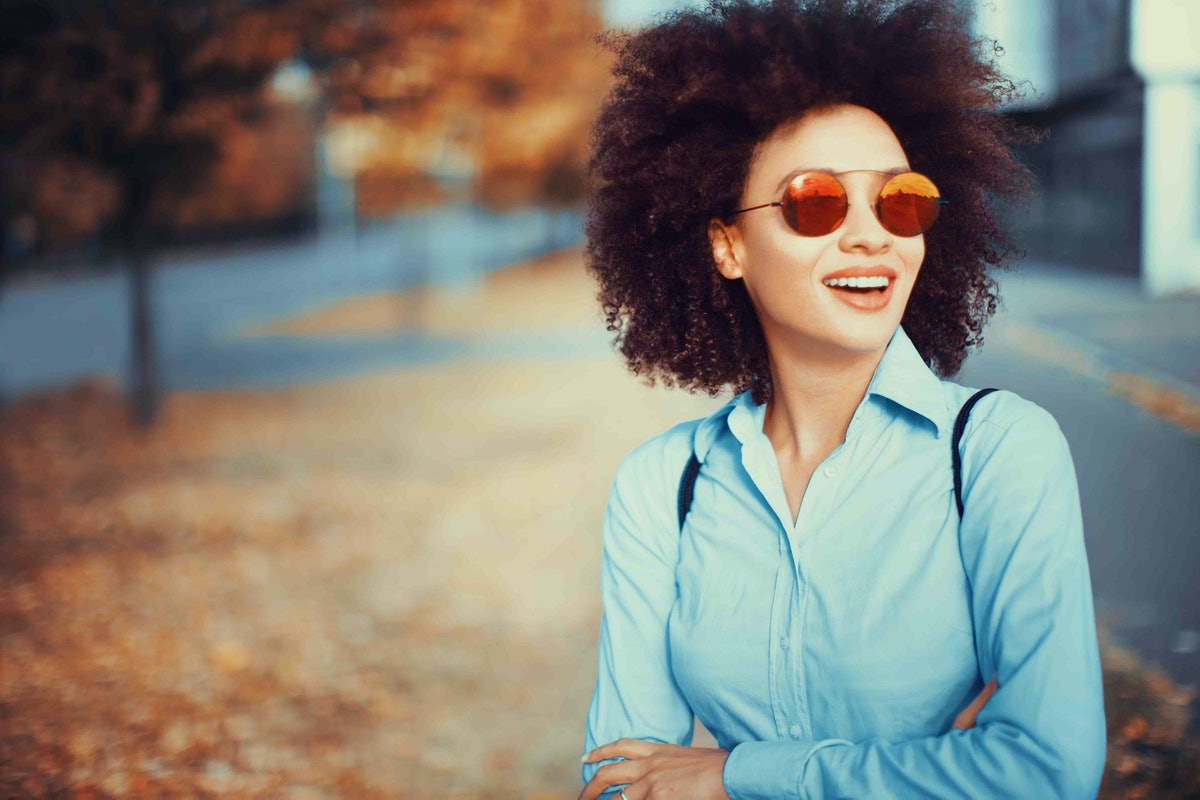 Young woman wearing sunglasses in autumn