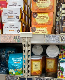Shelves full of a variety of fall flavored coffees and coffee pods.