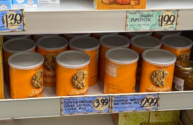 An image of oatmeal tins full of pumpkin chocolate chip cookie mix.