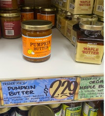 An image of a line of jelly jars, with pumpkin butter front and center.