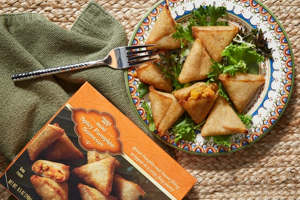 Trader Joe's Spicy Pumpkin Samosas sit on a colorful plate during the fall.