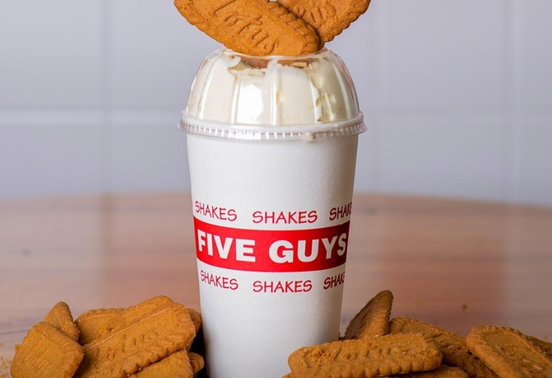 A five guys Biscoff milkshake with lotus biscuits on top and around the base