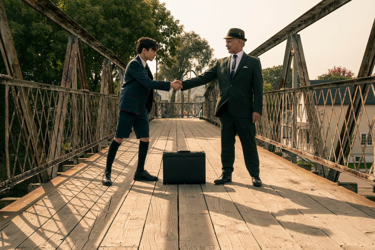 Aidan Gallagher and Sean Sullivan as Young Five and Old Five in 'The Umbrella Academy'