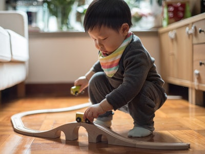 baby boy playing with train