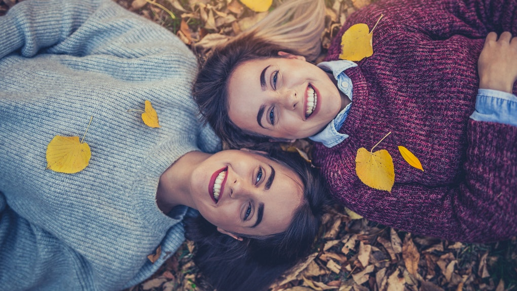 Twins in fall leaves