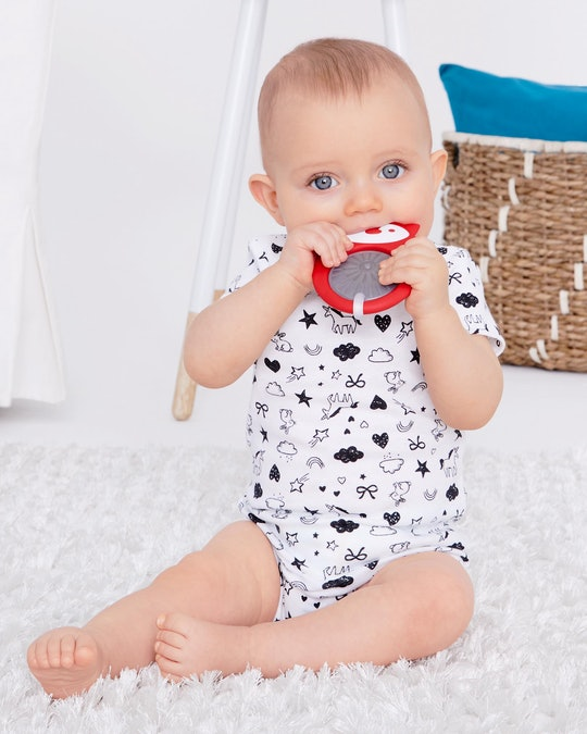 a baby with a skip hop teether