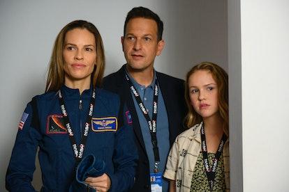 Hilary Swank as Emma Green, Josh Charles as Matt Logan, and Talitha Bateman as Alexis Logan in 'Away'