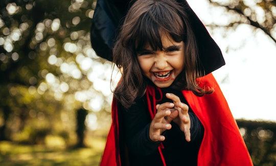 little girl dressed up as vampire
