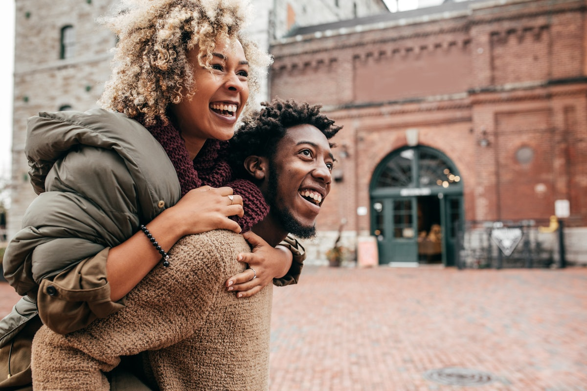 Young couple piggybacking in fall