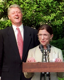 U.S. President Bill Clinton  laughs as newly confirmed U.S. Supreme Court Justice Ruth Bader Ginsburg stepped up the microphone to speak to the press in ceremonies in the Rose Garden at the White House August 3, 1993.
