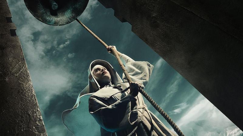 GEMMA ARTERTON as Sister Cloddagh in a nun's habit with a staff against a dark spooky-looking sky