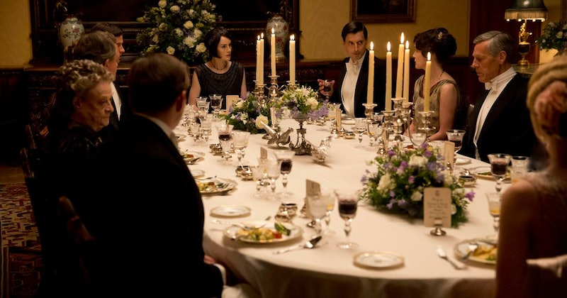 The Crawley family sit around the Christmas dinner table