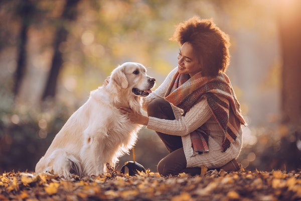 Young woman with dog in fall