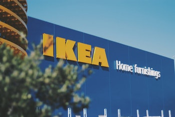 "The storefront for an Ikea can be seen with the title ""Home Furnishings"" on a blue background."