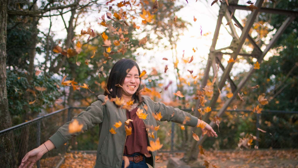 Young woman in fall foliage