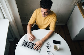 Man working from home at table.