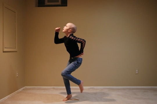child with cancer dancing in her living room