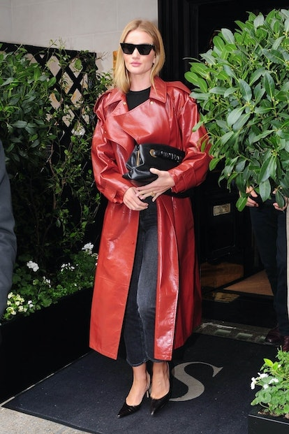 Rosie Huntington-Whiteley styles gray jeans with a red trench