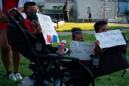 Children attend a protest to demand justice for the death of Breonna Taylor in front of Churchill Downs on Kentucky Derby weekend in Louisville, Kentucky.