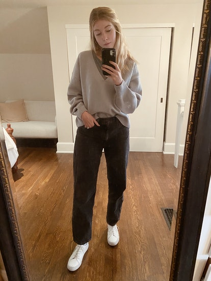 Style gray jeans with a slouchy sweater and sneakers when working from home