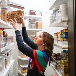 The Home Edit organizes a pantry on their new Netflix show. Experts explain why people are obsessed with cleaning & organizing videos.