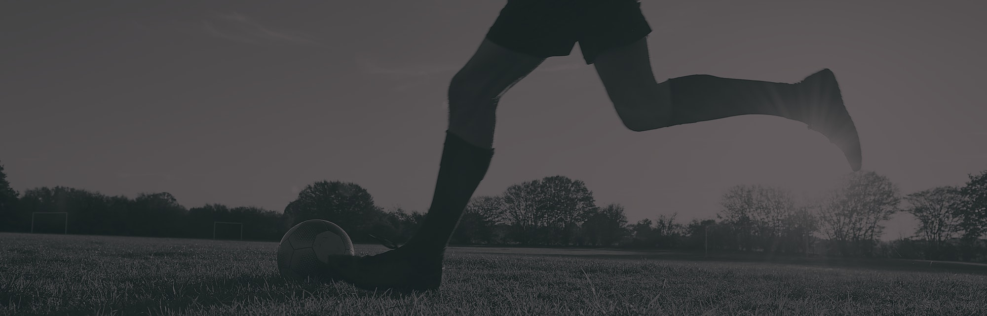 Man playing soccer in a field.