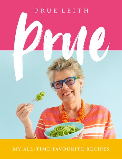 The cover of Prue Leith's My All Time favourite recipes featuring prue leith wearing a coral top and blue and green-framed glasses with a bowl of pasta and a fork which she's holding aloft