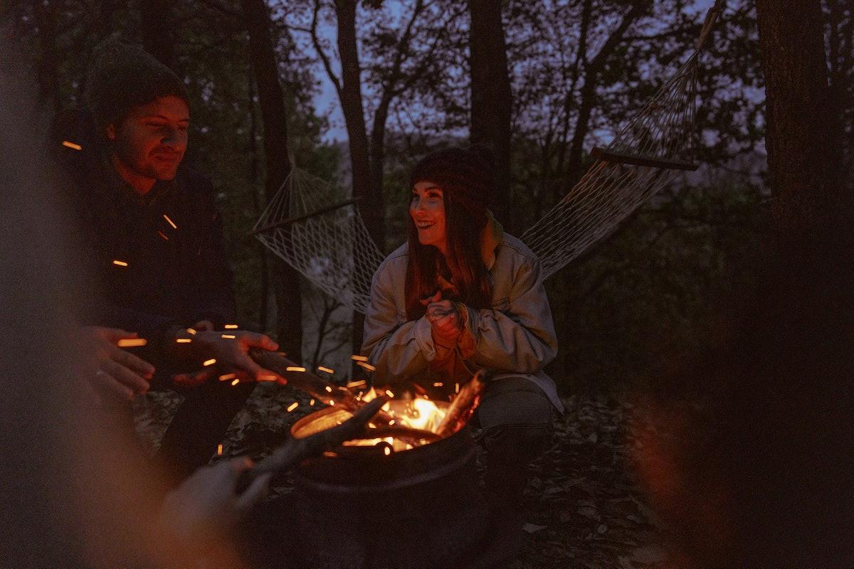 Friends around campfire