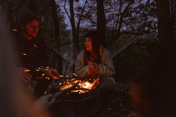 Friends around campfire