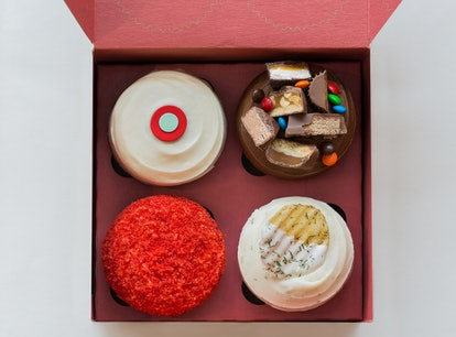 promo image of Sprinkles Pregnant AF box; closeup of each of the four cupcakes in a red box