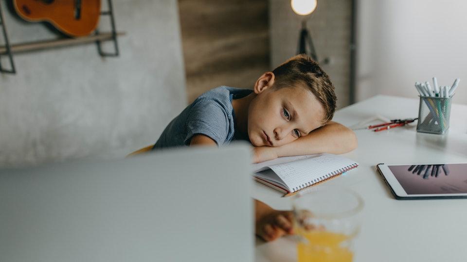 boy sad at desk, virtual bullying