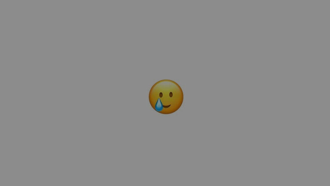 A smiley face for the iOS 14.2 which is also crying at the same time.