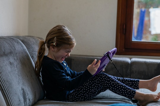 little girl screaming in frustration at tablet